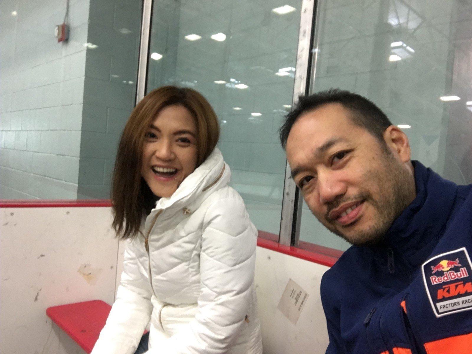 Woman and man at ice skating rink